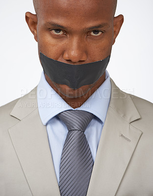 Buy stock photo Studio portrait of an african american businessman with his mouth covered by tape