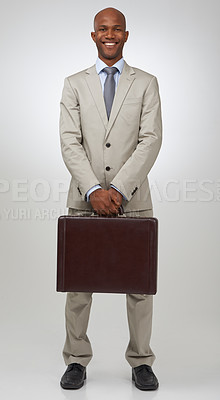Buy stock photo Portrait of a successful businessman holding a briefcase
