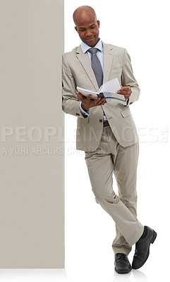 Buy stock photo An African-American businessman paging through a book - isolated