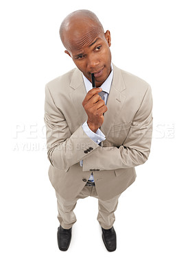 Buy stock photo A handsome african american businessman coming up with his business ideas