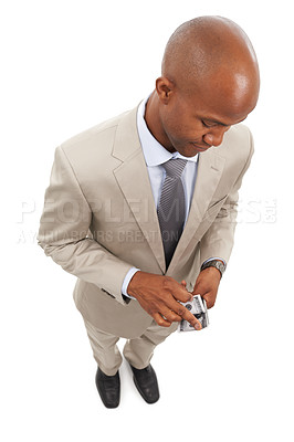 Buy stock photo An african american businessman counting a wad of cash while isolated on a white background