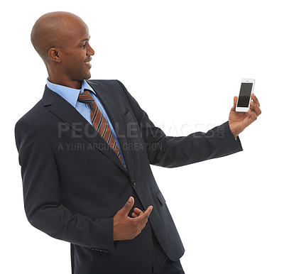 Buy stock photo An African-American businessman holding a cellphone against a white backgroujnd