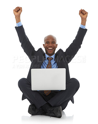 Buy stock photo A happy young ethnic man sitting with his laptop and his arms raised