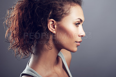 Buy stock photo A stunning young model posing thoughtfully in studio