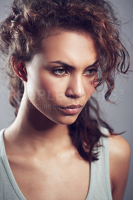 Buy stock photo Studio shot of a gorgeous young woman posing against a gray background
