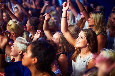 Buy stock photo A group of adoring fans singing along to their favorite song. This concert was created for the sole purpose of this photo shoot, featuring 300 models and 3 live bands. All people in this shoot are model released.