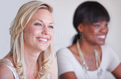 Buy stock photo A young businesswoman smiling while sitting at her desk