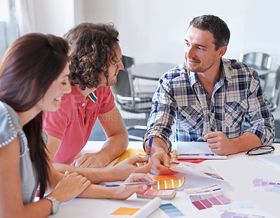 Buy stock photo A group of interior designers deciding on colours in their studio