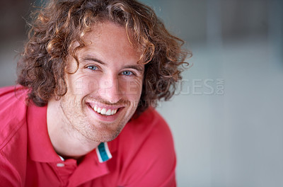 Buy stock photo A young man beaming at you confidently