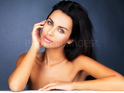 Buy stock photo Portrait of a cute young woman isolated on blue background