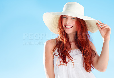 Buy stock photo A beautiful young redheaded woman wearing a white sunhat while standing outside