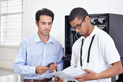 Buy stock photo two men looking at an instruction manual