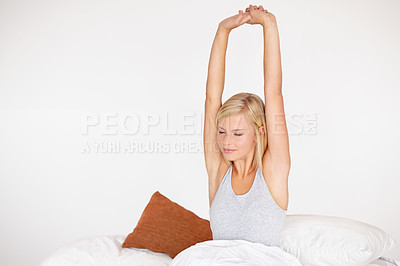 Buy stock photo Shot of a beautiful young woman in her bedroom