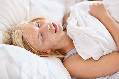 Buy stock photo Shot of a young woman in bed in the morning