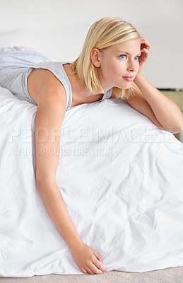 Buy stock photo An attractive young woman lying on her bed
