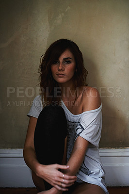 Buy stock photo Cropped portrait of a young woman sitting at home