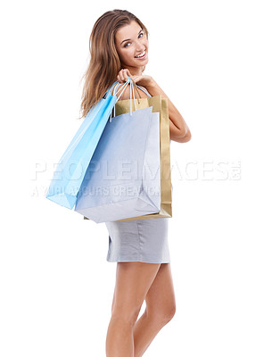 Buy stock photo Studio portrait of an attractive young woman carrying a bunch of shopping bags