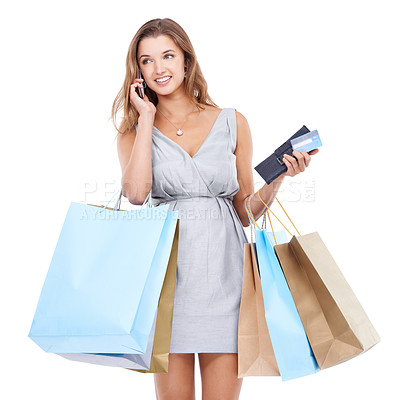 Buy stock photo An attractive young woman talking on her cellphone whlle out on a shopping spree