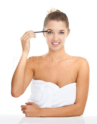 Buy stock photo Portrait of an attractive young woman applying eye shadow