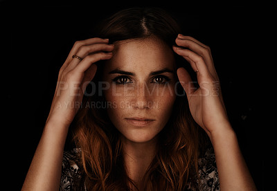 Buy stock photo A dark portrait of a young woman