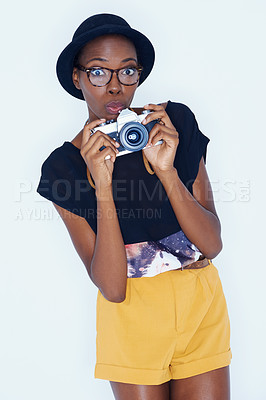 Buy stock photo A young woman taking a photograph of you