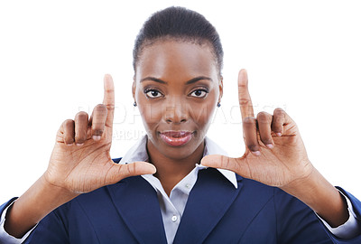 Buy stock photo Studio shot of a young businesswoman framing her face with her fingers