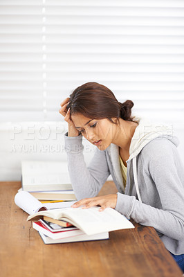 Buy stock photo A pretty college student struggling with her studies