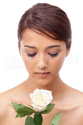 Buy stock photo A beautiiful, young woman smelling a white rose