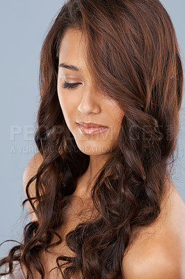 Buy stock photo A beautiful woman looking down with curled hair