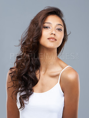 Buy stock photo Portrait of a serious beautiful woman