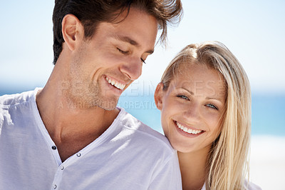 Buy stock photo A young couple having an intimate moment on the beach