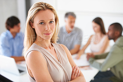 Buy stock photo A beautiful business manager crossing her arms in the boardroom