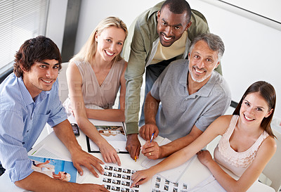 Buy stock photo A diverse group of colleagues working on a project together in the boardroom