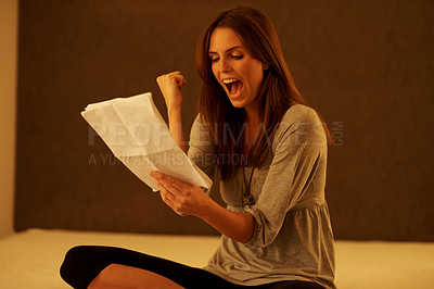 Buy stock photo Pretty excited young woman reading a documents