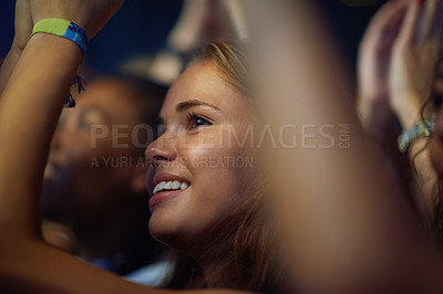 Buy stock photo Shot of a young woman in a crowd at a concert. This concert was created for the sole purpose of this photo shoot, featuring 300 models and 3 live bands. All people in this shoot are model released.