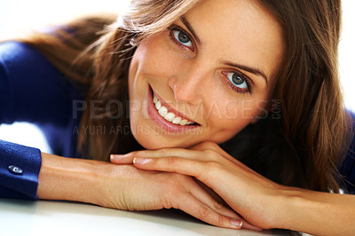 Buy stock photo Beautiful woman lying down on floor and smiling