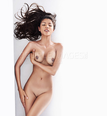 Buy stock photo Cropped shot of a nude woman lying with her eyes closed