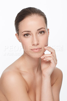 Buy stock photo Cropped portrait of a nude young woman with flawless skin against a white background