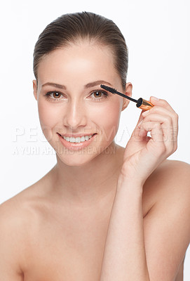 Buy stock photo A gorgeous young woman applying makeup