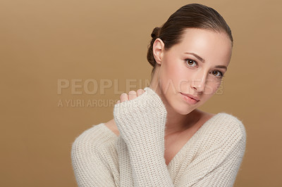Buy stock photo Cropped portrait of a beautiful young woman wearing a warm winter sweater