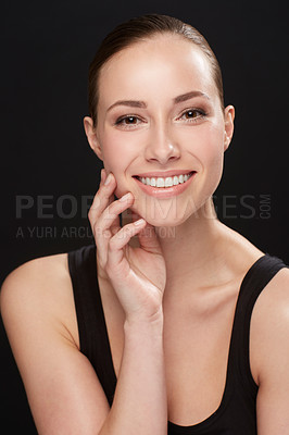 Buy stock photo Studio shot of an attractive woman isolated on black