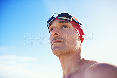 Buy stock photo A young man with goggles on the beach