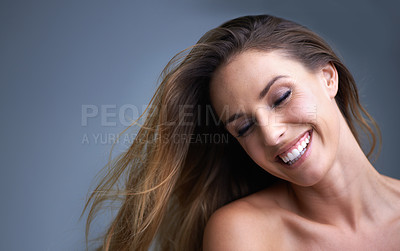 Buy stock photo An attractive young woman smiling happily in studio
