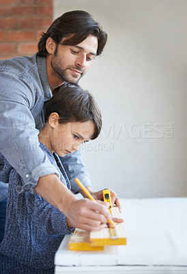 Buy stock photo A father and son doing woodwork together