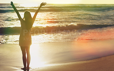 Buy stock photo Shot of a young woman at the beach