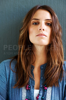 Buy stock photo Young woman posing confidently agaist grey backgro