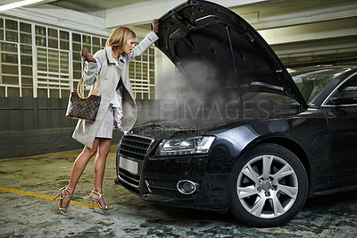 Buy stock photo Full length of a young woman standing alongside her broken down car