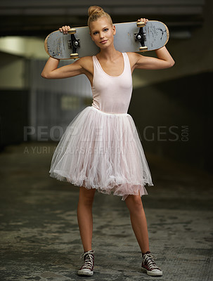 Buy stock photo A young ballerina holding a skateboard while wearing a tutu and sneakers