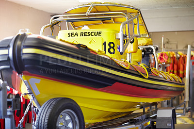 Buy stock photo Cropped shot of a sea rescue boat inside a lifeguard station