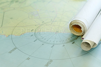 Buy stock photo Shot of nautical maps on a table